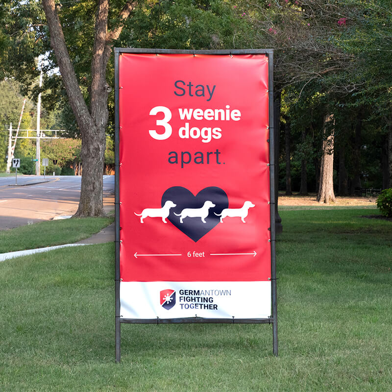 Outdoor signs in the City of Germantown, promoting Covid-19 safety procedures, with funny headlines like stay three wiener dogs apart