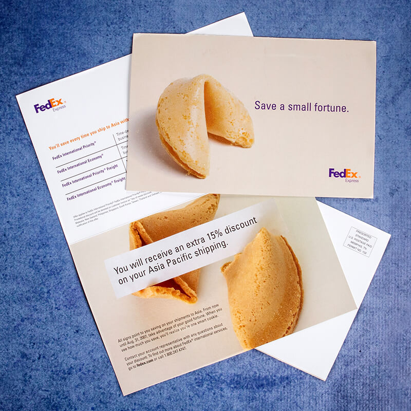 Direct-mail piece for FedEx, promoting discounts on shipping to Asia, showing a fortune cookie with the headline save a small fortune